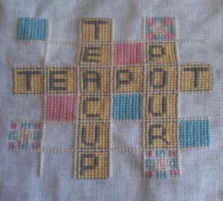 cross-stitch scrabble reading teacup, teapot, pour