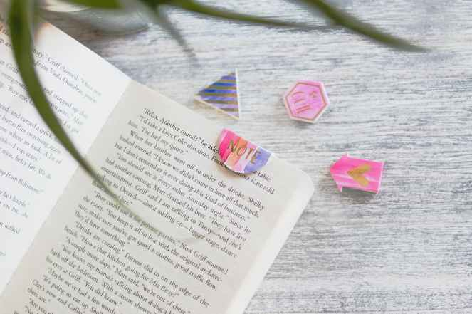 opened book with pink note bookmark
