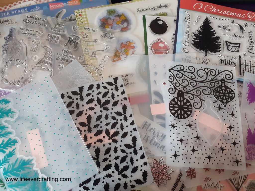 Photo showing Christmas-related stamps and embossing folders for card-making