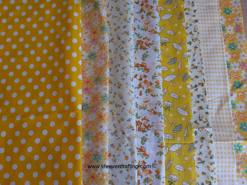 The image shows eight fat quarters, each with a different pattern of dots, flowers and gingham.